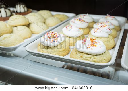 Artisanal Cupcakes And Cookies At A Bakery On Display