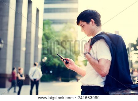 Young adult man checking his smartphone