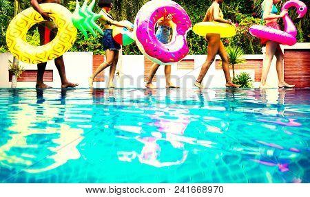 Friends enjoying a pool party