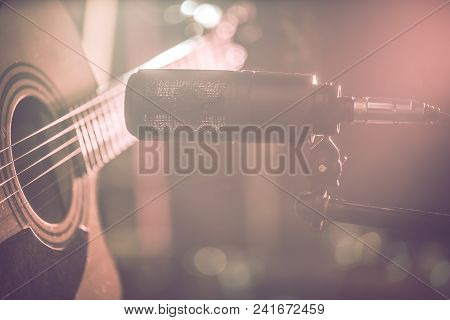 The Studio Microphone Records An Acoustic Guitar Close-up, In A Recording Studio Or Concert Hall, Wi