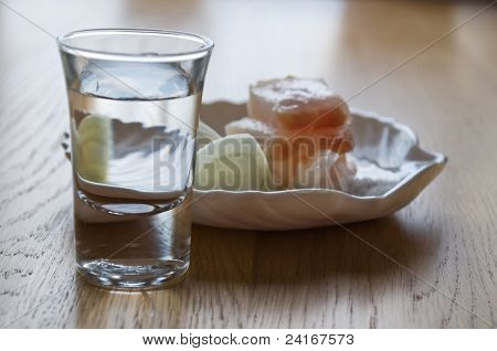 Glass With Vodka And A Small Dish Of Lard And Onions