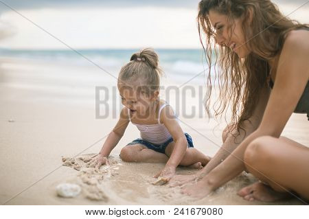 Children's Day. Mom And Baby Playing Near Beach.
