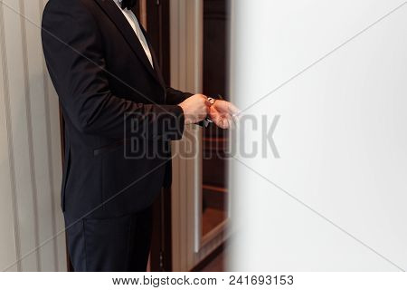 Elegant Young Fashion Man Dressing Up For Wedding Celebration. Color Close Up Image Of Male Hands. H