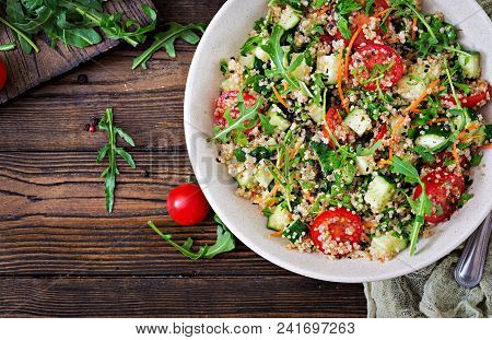 Salads With Quinoa,  Arugula, Radish, Tomatoes And Cucumber In Bowl On  Wooden Background.  Healthy
