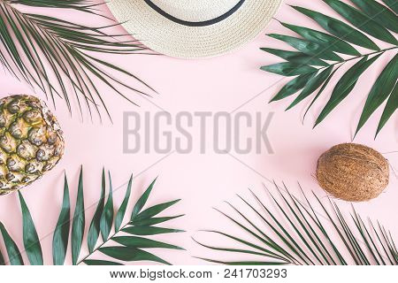 Summer Composition. Tropical Palm Leaves, Hat, Pineapple, Coconut On Pastel Pink Background. Summer