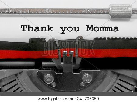Thank You Momma Phrase Written By An Old Typewriter On White Sheet