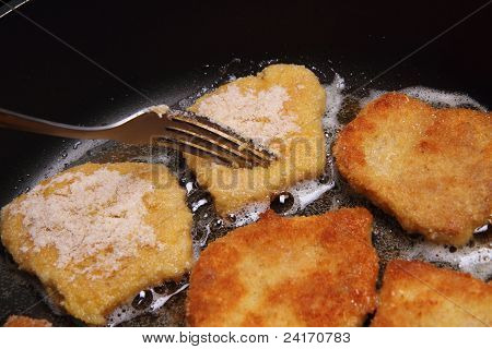 Soy Meat being fried on a pan poster
