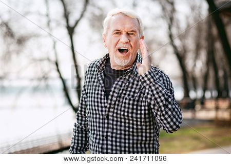 Time To Go. Attractive Senior Man Posing In Park And Shouting
