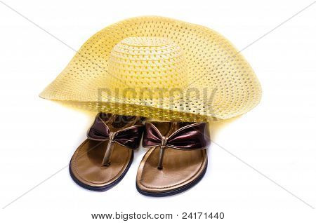 A Straw Hat And Beach Shoes