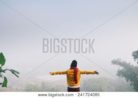 Woman Standing Among Fog Mist To Freedom