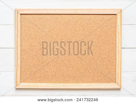 Blank Cork Board With Corkboard Texture Background With Wooden Frame Hanging On White Wood Wall For