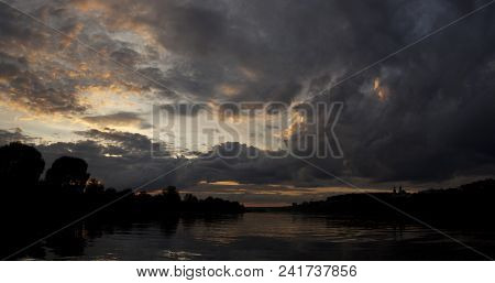 The Surface Of The River At Sunset In Summer