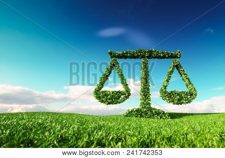 Eco Friendly Law, Politics And Eco Balance Concept. 3d Rendering Of Scale Icon On Fresh Spring Meado