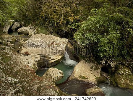 Gorge With A Mountain River In The Wild.
