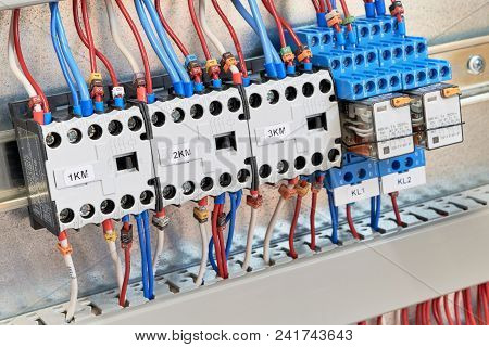 Three Magnetic Contactors And Two Intermediate Relays In An Electric Cabinet. Electrical Equipment I