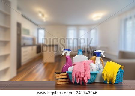 Home Cleaning Service Concept With Supplies. Close Up Of Cleaning Supplies In Front Of Livingroom.