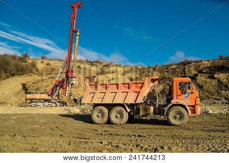 View Of Truck And Drilling Machine At Road Works In The Country In Autumn. Industrial Concept