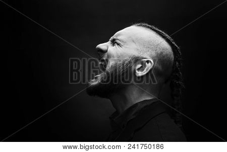 Brutal Man With Dreadlocks Screams In A Rage, Looks Like A Viking, Iroquois Haircut