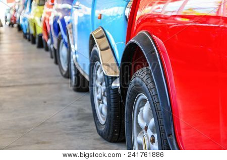 Colorful Cars Standing In Line On Parking Cars, Different Colored Cars Of Sideview