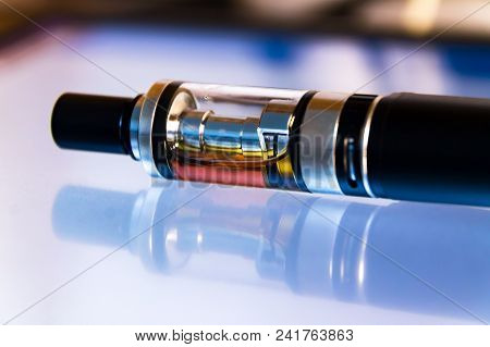 Advanced Vaping Device, E-cigarette On Table, Black Electronic Cigarette With Reflection