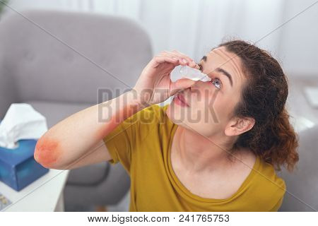 Self Medicating. Young Sicl Looking Woman Trying To Perform Self Treatment On Her Infected Eye Witho