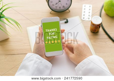 Thanks For Rating Message On Smartphone Screen In Female Doctor Hand. Patients And Customer Service