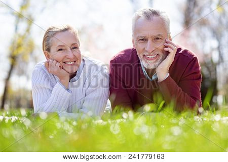 Romantic Weekend. Nice Delighted Couple Looking At You While Enjoying Their Romantic Weekend
