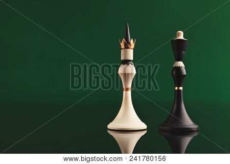 Pair Of King Chess Pieces Confronted As Opposites On Green Background With Reflection. Forbidden Lov
