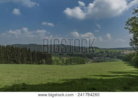 Meadows And Pasture Land Near As Town In Spring Day