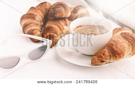 Croissants With A Cup Of Coffee On A White Background