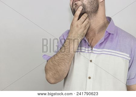 Man Checking How Is Growing Growing His Beard.