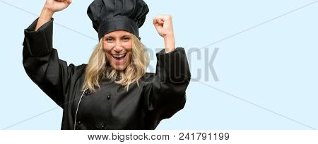 Beautiful cook woman chef happy and excited celebrating victory expressing big success, power, energy and positive emotions. Celebrates new job joyful