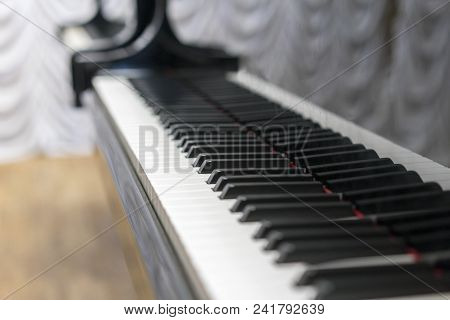 Piano Keys Close-up, Selected Focus. Close Up View Of Black Piano Keys , Selected Focus