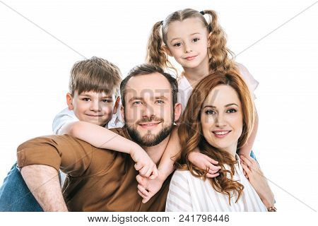 Happy Family With Two Children Smiling At Camera Isolated On White