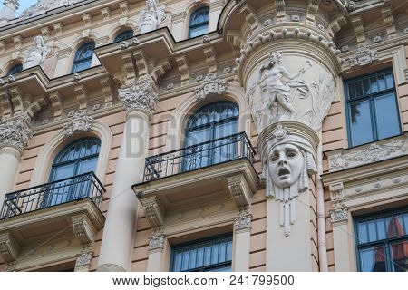 poster of Art Nouveau architecture on a building facade in Riga, Latvia