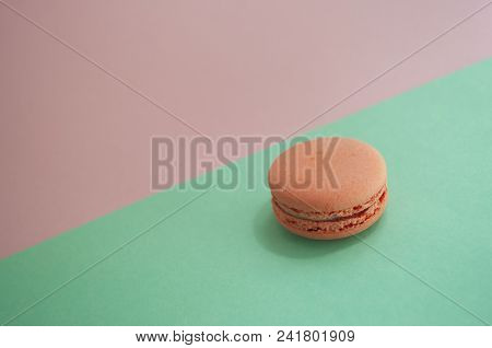 Rose Quartz Color Macaroon On Turqoise And Pink Background With Text Space.