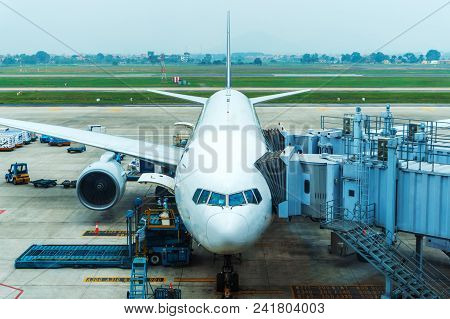 Passenger Airplane Parked At The Airport And Preparation For Next Flight. Aircraft Maintenance At Ai