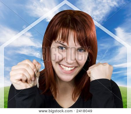 Successful Girl Smiling Holding Keys With A House Symbol Background