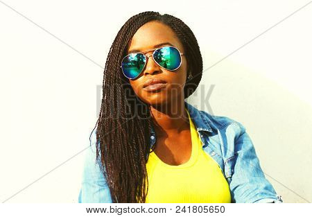 Pretty African Woman In Sunglasses Over White Background