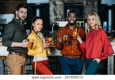 Group Of Happy Friends With With Various Alcohol Beverages Spending Time Together In Bar