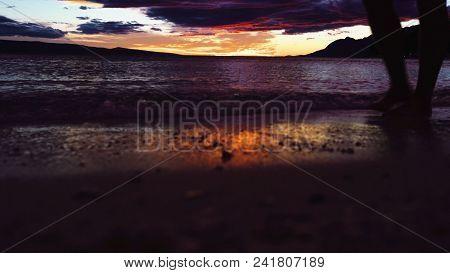 Running Legs Silhouette On Sea Sunset Background. Silhouette Legs On Sea Sunset. Sea Sunset. Sunset