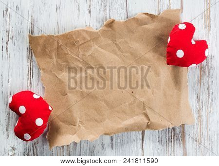 Brown Package Paper And Love Hearts On Wooden Background
