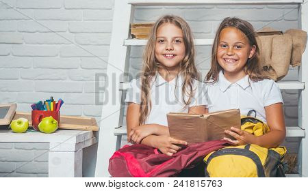 Story Reading. Story In Book At Two Small Girls.