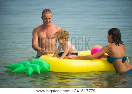 Summer Vacation And Travel To Ocean. Summer Vacation Of Happy Family In Water