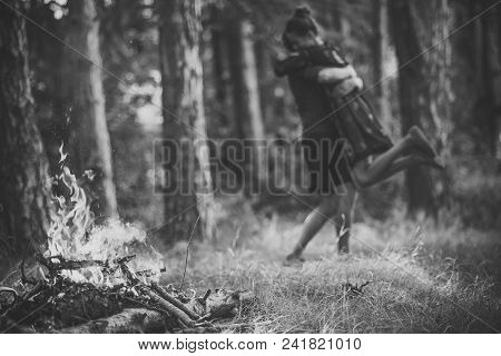 Prelude - Couple In Love. Bonfire Flame Burn Firewood In Forest With Blurred Couple In Love Hug On N