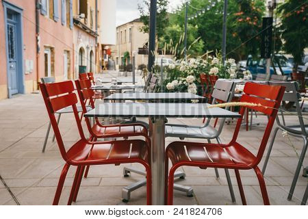 Theme Cafes And Restaurants. Exterior Summer Terrace Of Bright Colors Of Street Cafe Shop In Europe