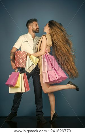 Black Friday, Happy Holiday, Relations. Fashion Shopaholic Couple. Girl And Bearded Man Hold Present