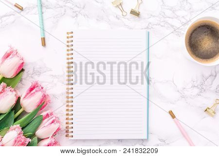 Festive golden stationary on white marble background. Feminine job, gender equality, home office and career concept. Copy space Top view.. Vertical poster