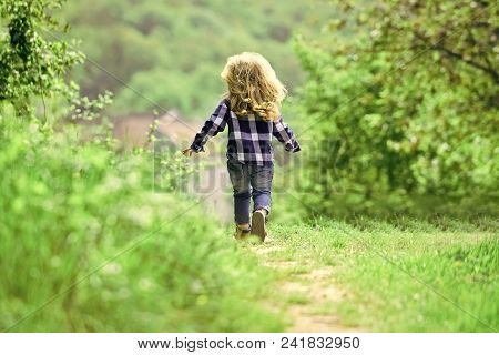 Childhood. Child Run On Path In Spring Or Summer Park. Boy With Long Blond Hair On Idyllic Day. Chil