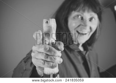 Cleaning And Purity. Woman With Long Hair Hold Soup Bottle. Old Lady Cleaner With Broom On Blue Back